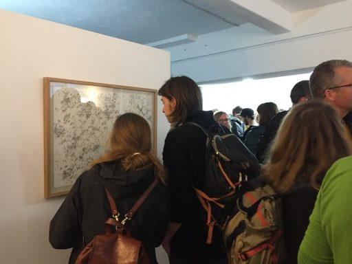Gallery visitors looking at Lucy Ward's 'You Guys'