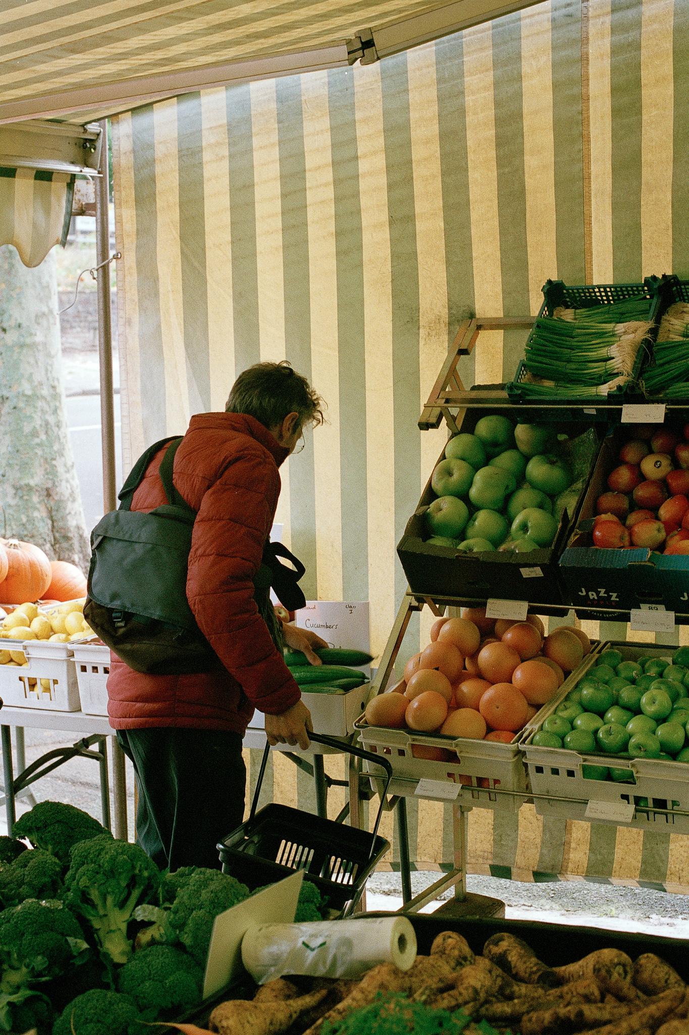 fruit and veg shop with a man picking up produce