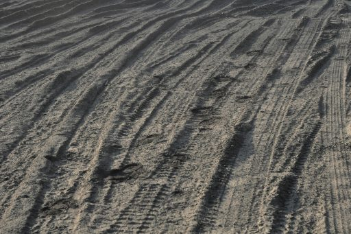 tire tracks on the soft ground