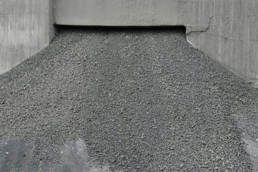gravel falling from an opening in a structure