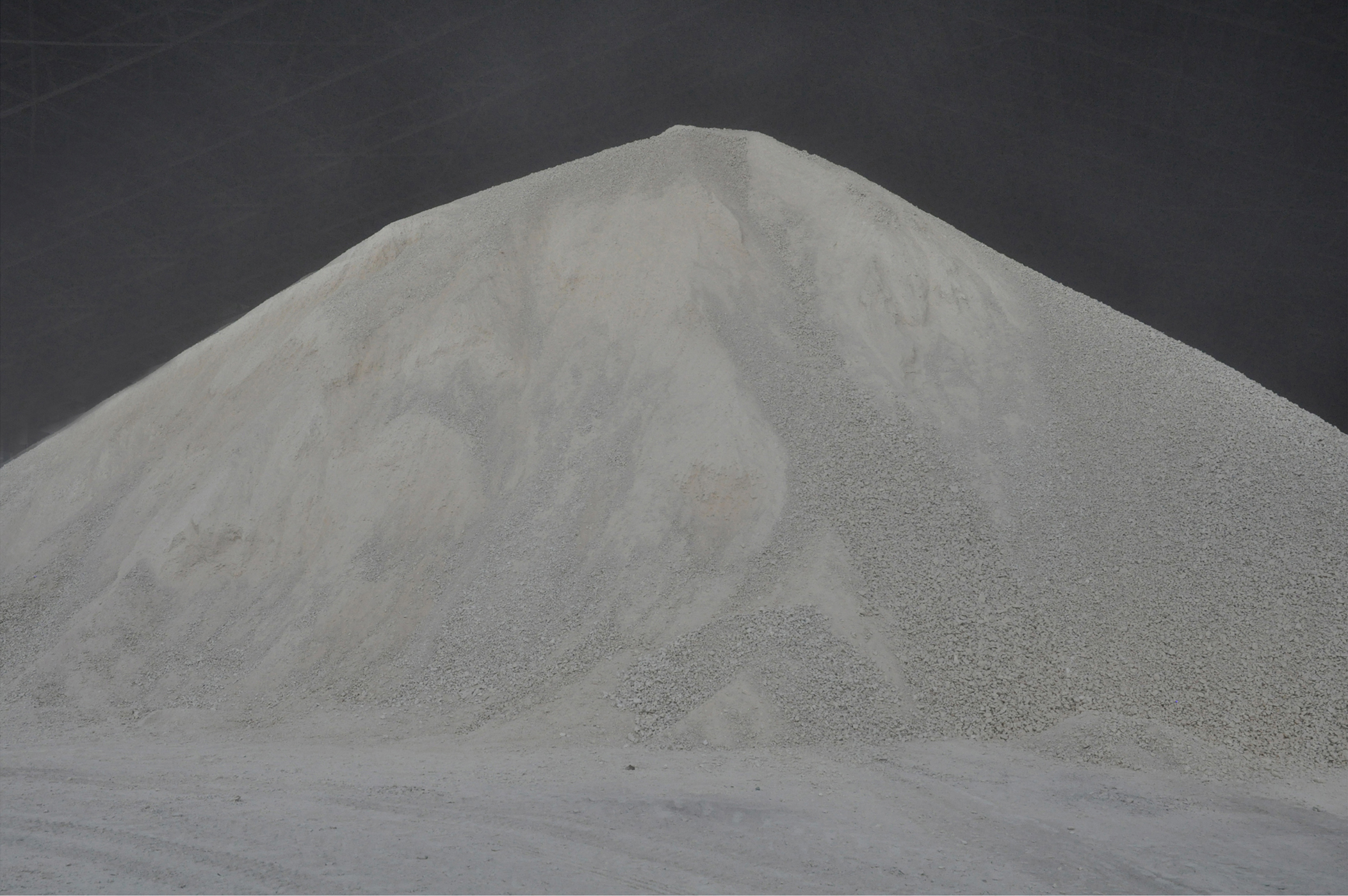 large mound of white gravel and sand