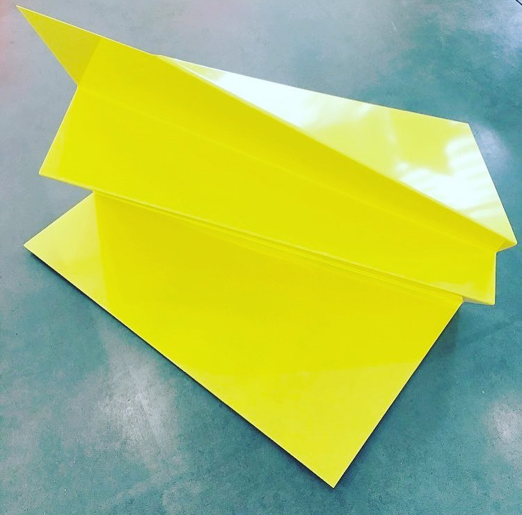yellow sculpture made of folded metal