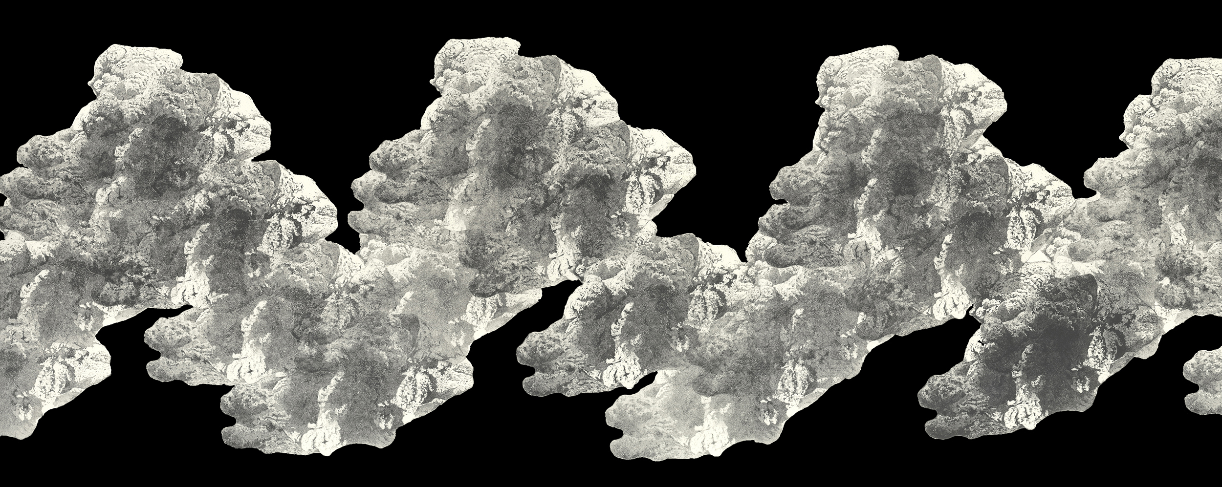 Black and white image of rocks or clouds in chain.