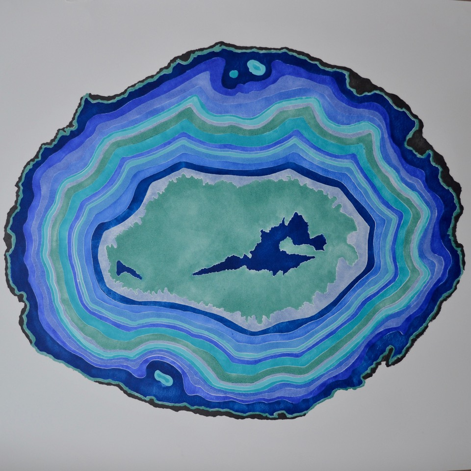 bright blue and green print to look like cross section of a gemstone
