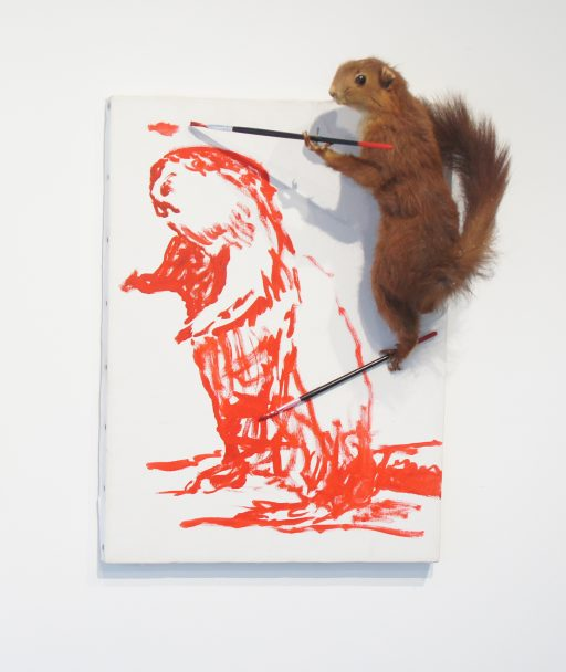 A taxidermy squirrel painting a squirrel on a canvas