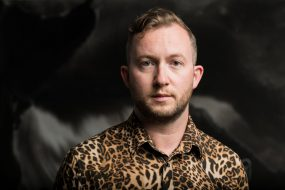 Portrait of person wearing patterned shirt