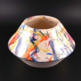 Image of a geometric pot decorated with splashes of colour