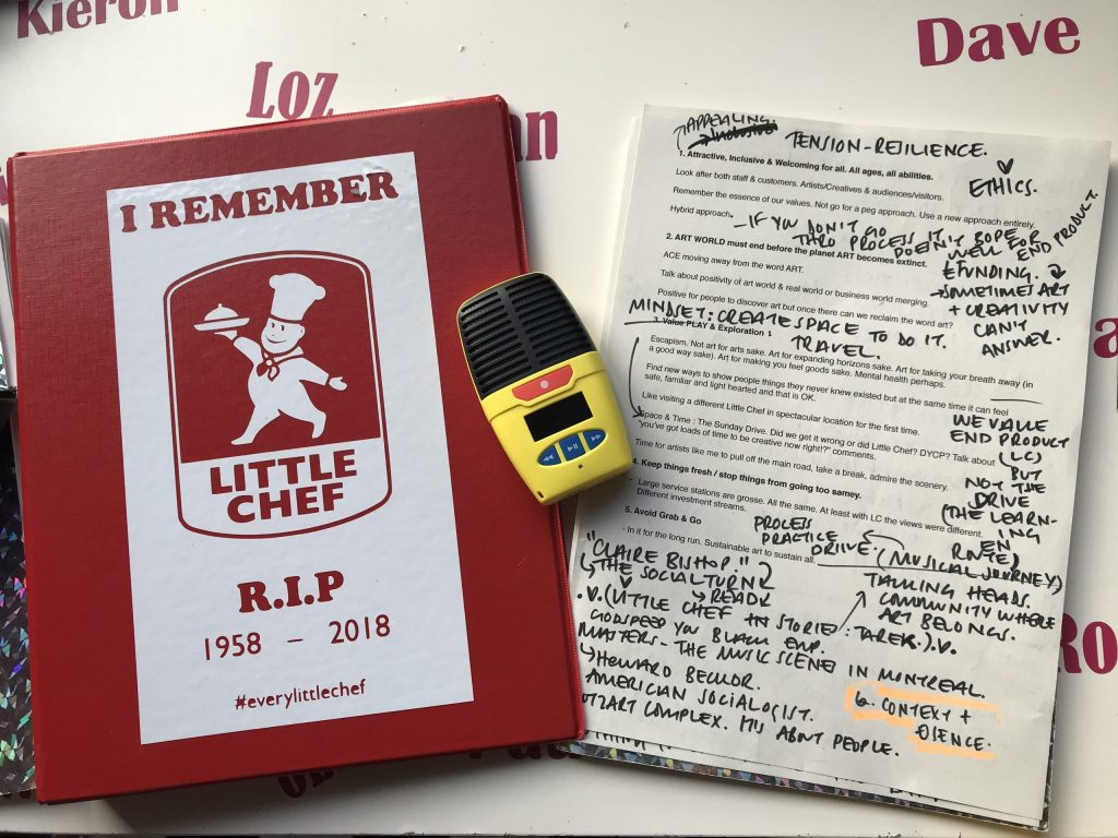 Red Little Chef funeral folder, notepad with written thoughts scribbled on it and yellow dictaphone on desk.
