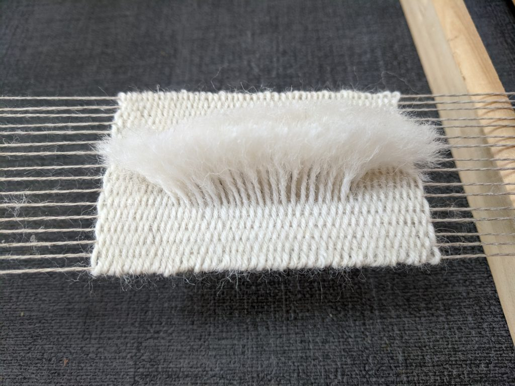 test piece of weaving with sheeps wool