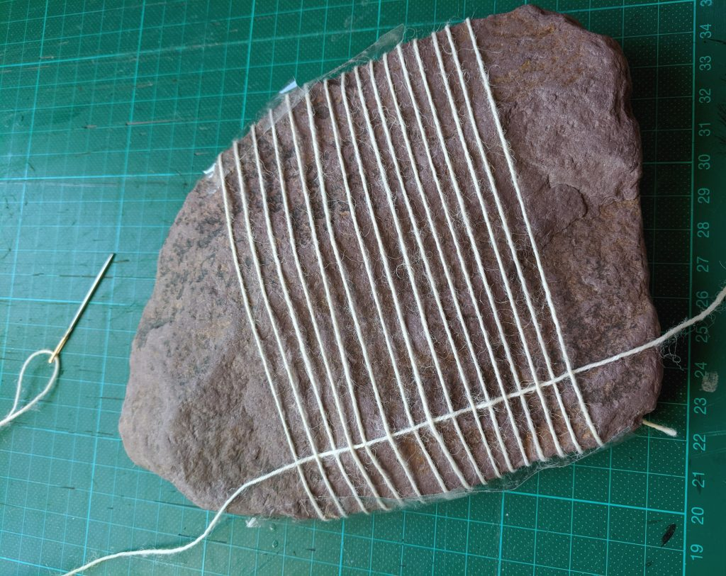 Setting the warp on a larger rock