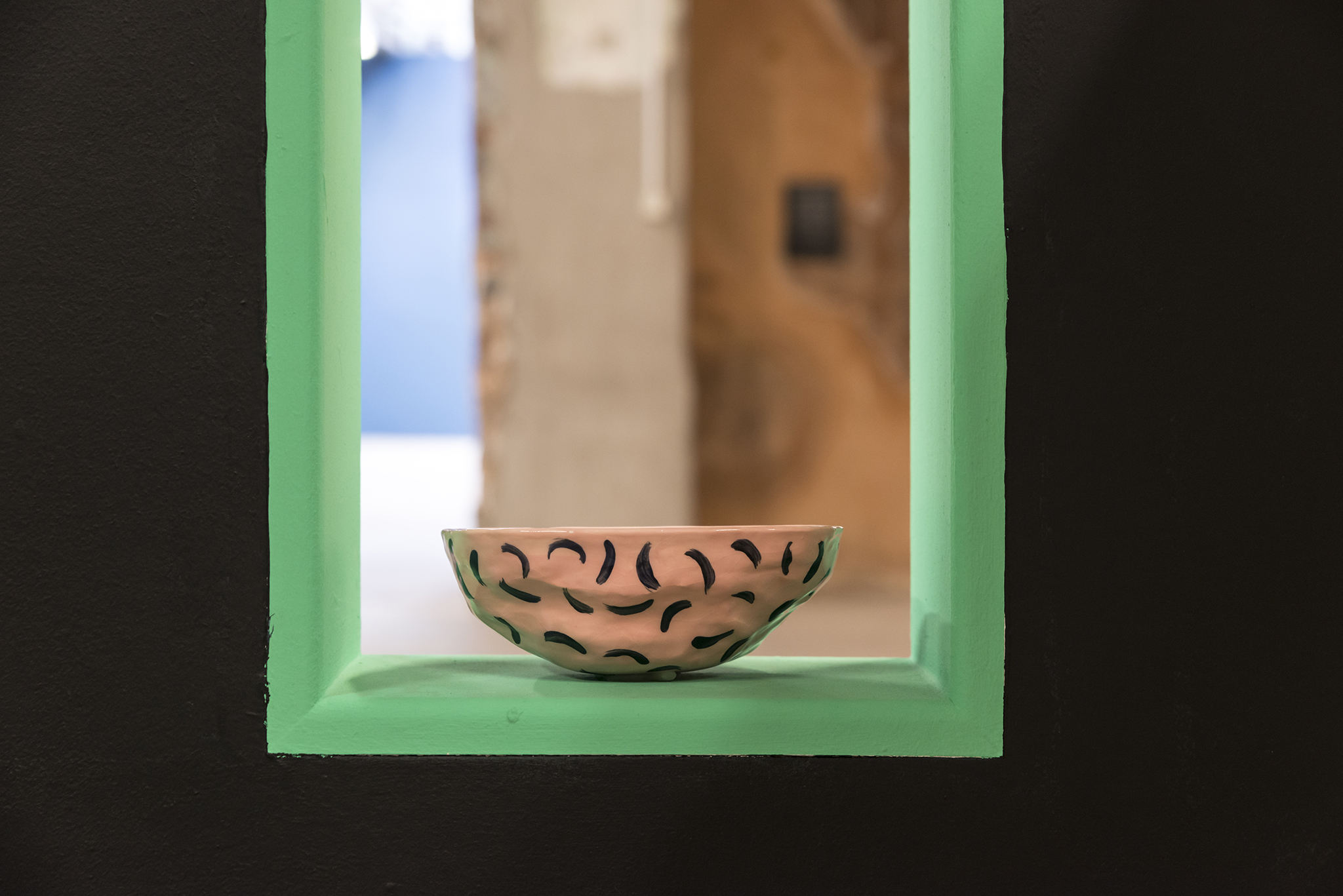patterned soap dish on green window ledge