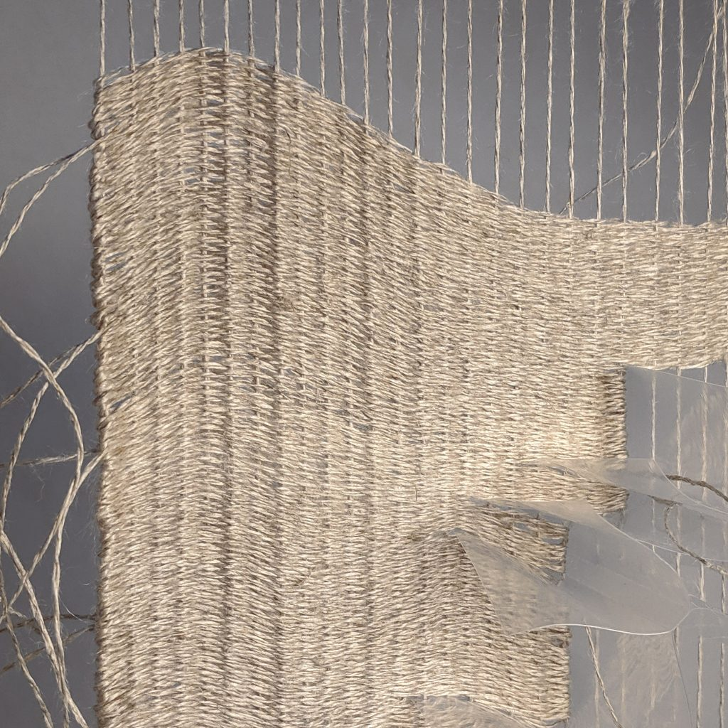 Close up of plastic and linen weave