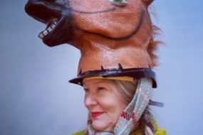 Woman with horse head on top of her head