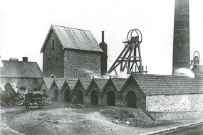 Easton Colliery, shown in 1800s black and white image, with colliery lift wheel and tall brick chimney