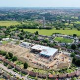 Trinity Academy Lockleaze, aerial view - midway through the build process. Purdown hill to the top of the image and housing around the rest of the site